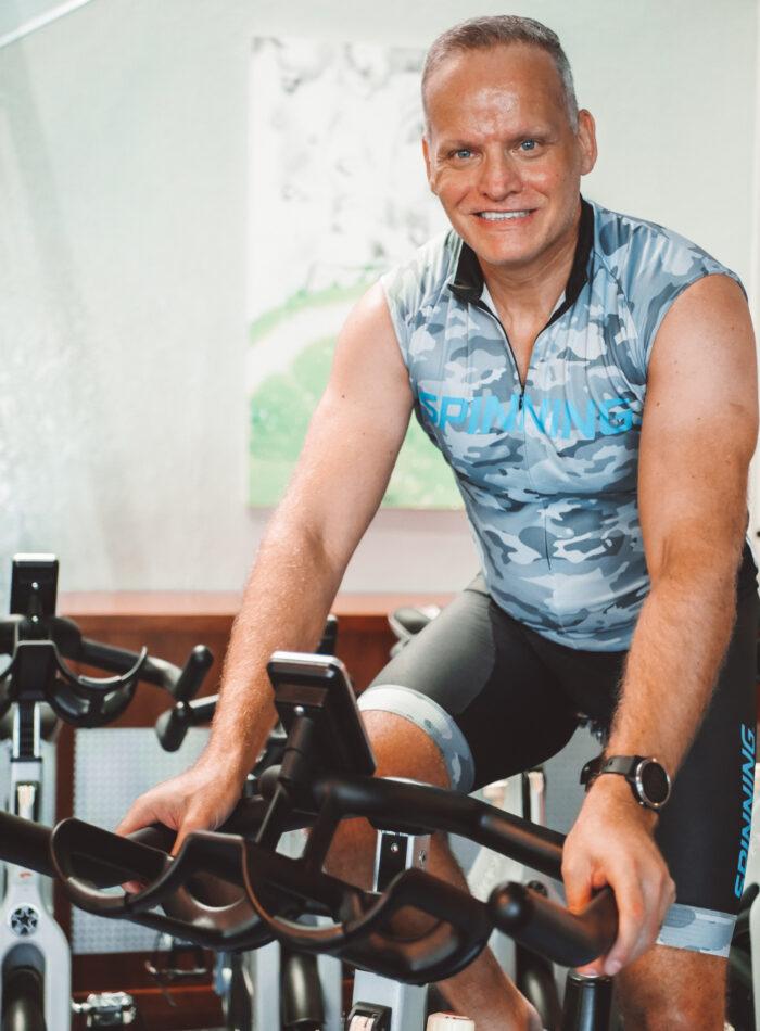Lee cycling at The Club Abu Dhabi